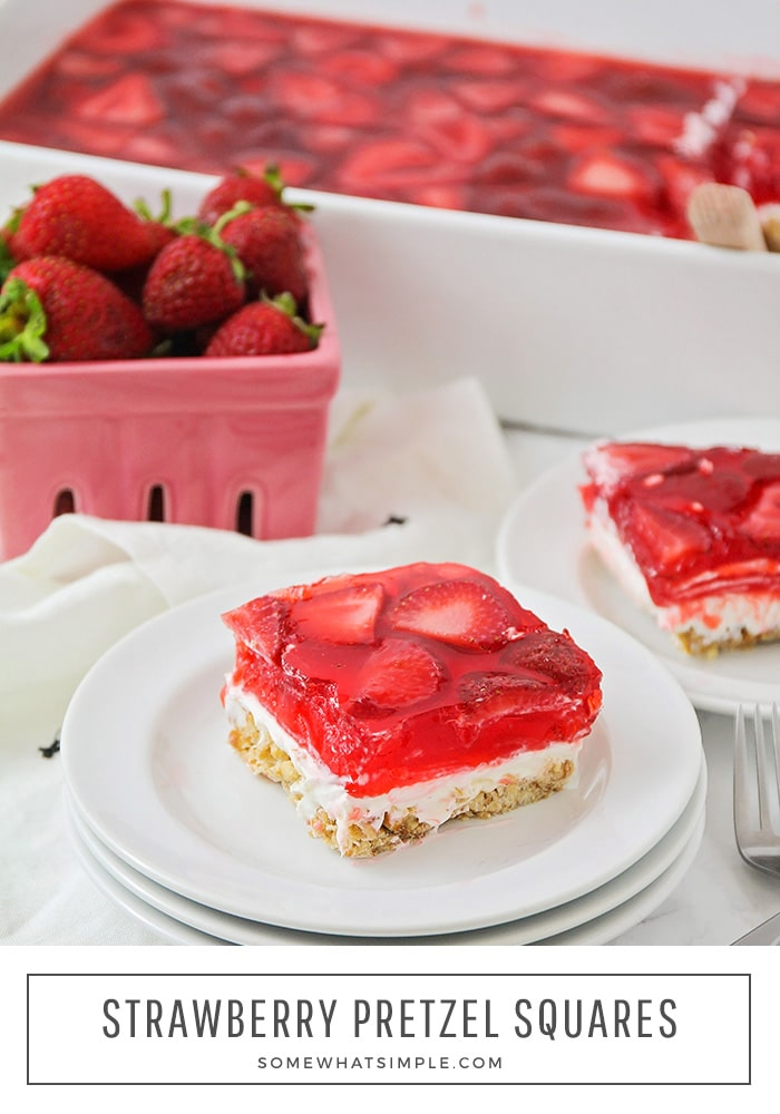 These simple strawberry pretzel squares have layer upon layer of deliciousness! A crunchy pretzel crust topped with a sweet cream cheese layer and fresh strawberry topping - they are simple to make and taste amazing! #strawberrypretzelsalad #strawberrypretzeldessert #strawberrypretzeljellosalad #strawberrypretzelsaldrecipe #strawberrypretzeldessertrecipe via @somewhatsimple
