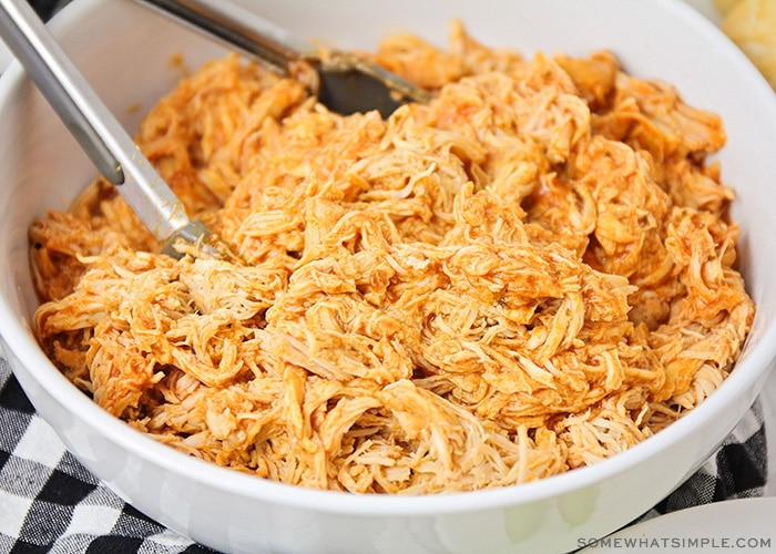 shredded buffalo chicken in a white bowl