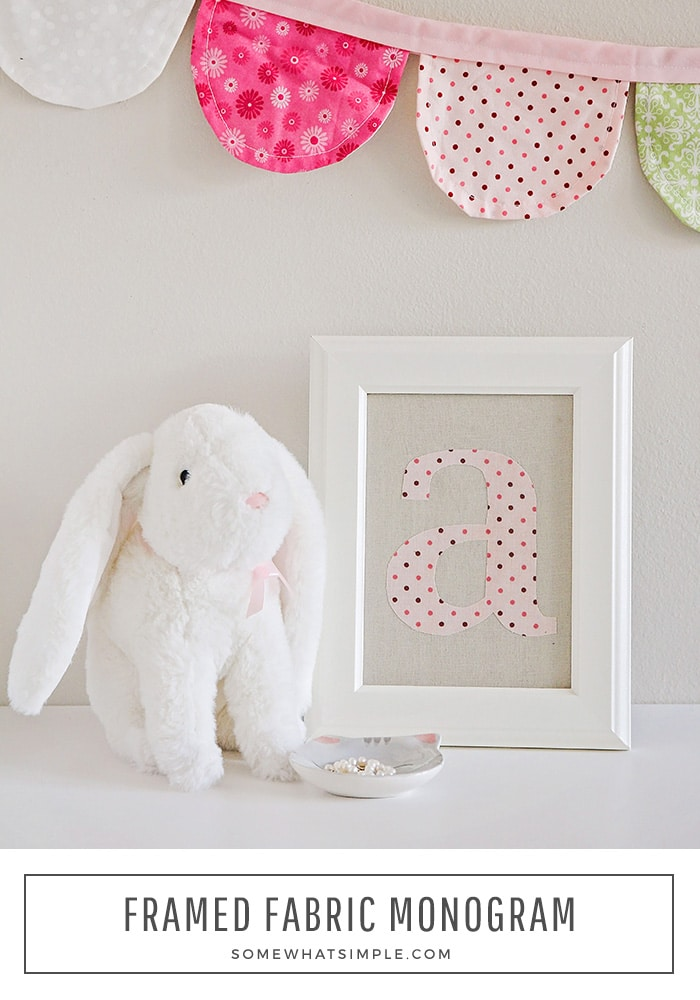 A framed fabric monogram is a no-sew project that could not be any easier to create! Make one for your home in ten minutes or less! #fabricmonogram #nosewfabricmonogram #howtomakeafabricmonogram #fabricmonogramapplique via @somewhatsimple