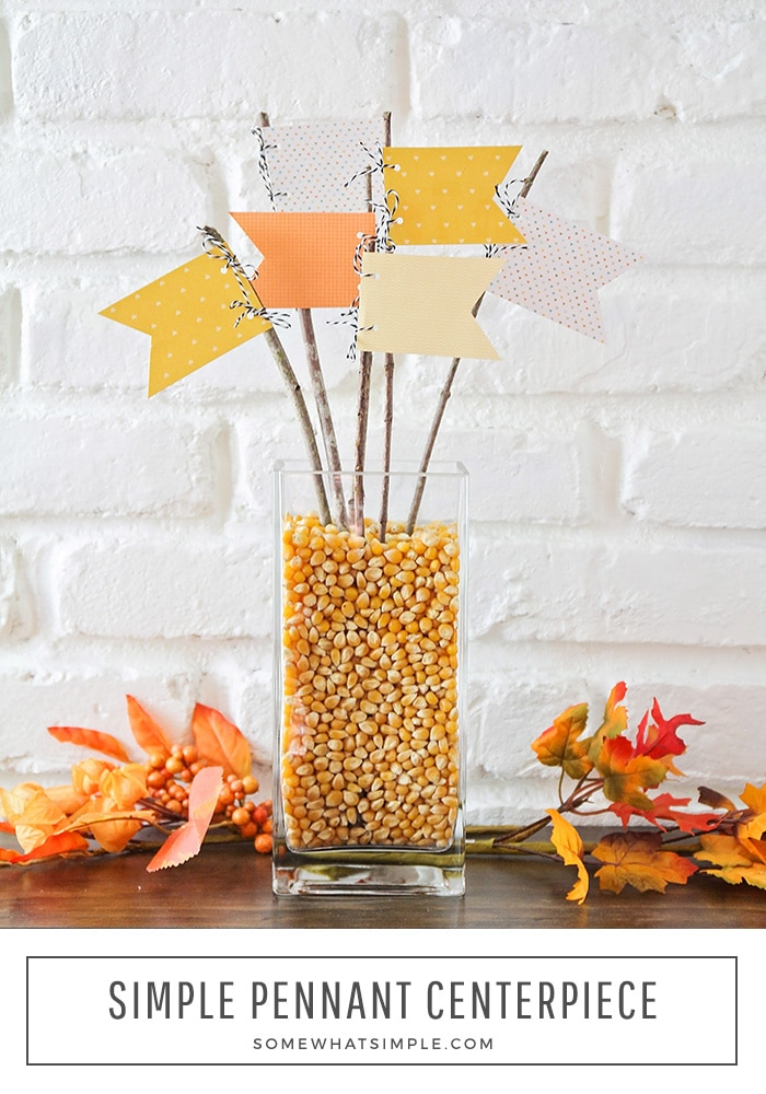 This fun fall centerpiece is made with scrapbook paper and twigs from the yard! It's festive, versatile and so easy to make! #diyfallcenterpiece #falltablecenterpiece #fallcenterpieceidea #fallcenterpiece #easyfallcenterpiece