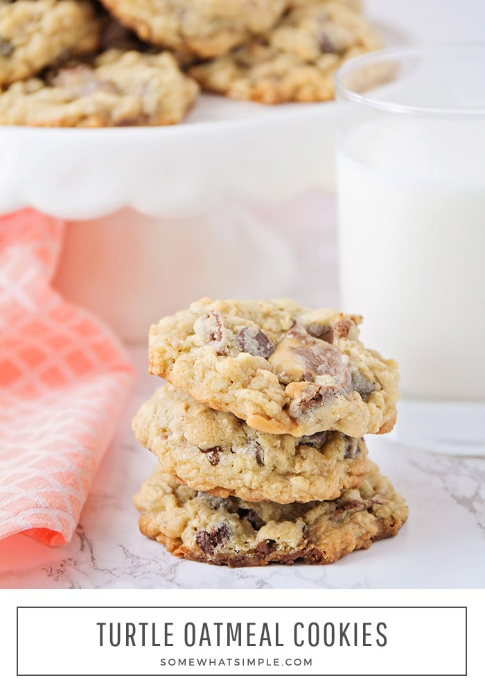 a stack of turtle oatmeal cookies next to a glass of milk