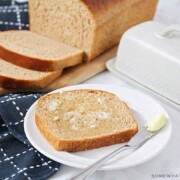 a slice of homemade wheat bread topped with butter