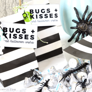 a close up of the bugs and kisses printable with hershey's kisses and plastic bugs next to them