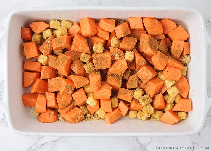 looking down on diced sweet potatoes topped with brown sugar