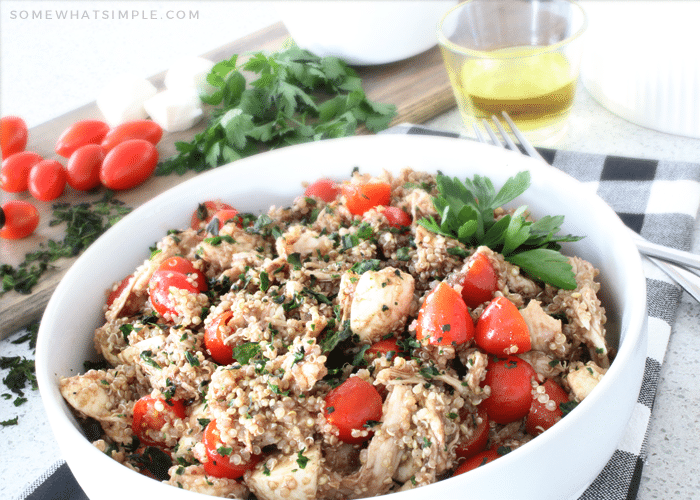 a bowl filled with Caprese quinoa salad