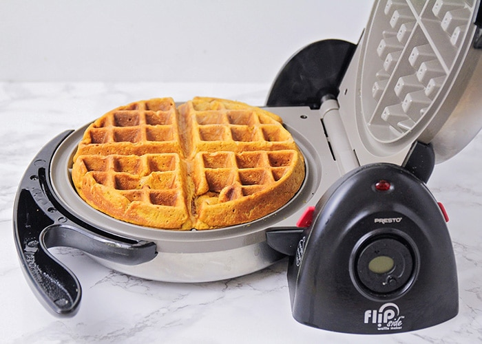 a freshly cooked gingerbread waffle in a waffle maker