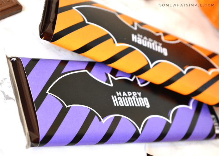 a close up of candy bars with a bat wrapper around them that says happy haunting