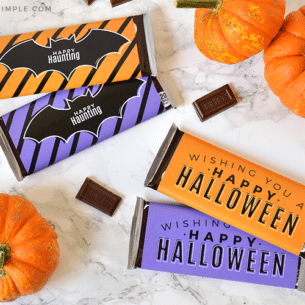 candy bars wrapped in orange and purple halloween wrappers