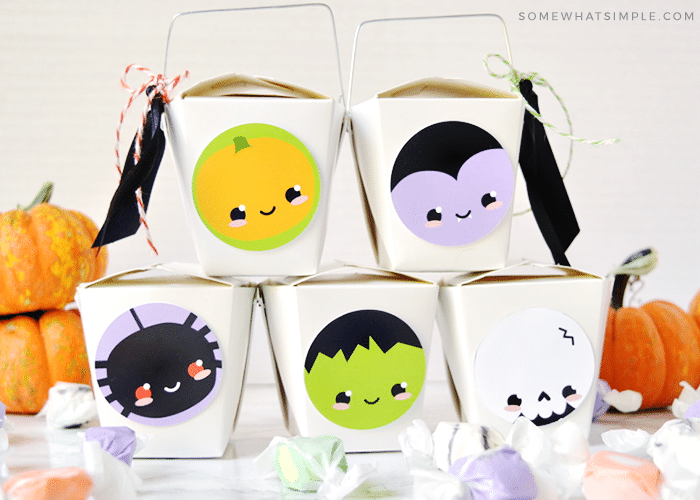a stack of halloween gifts made with takeout boxes