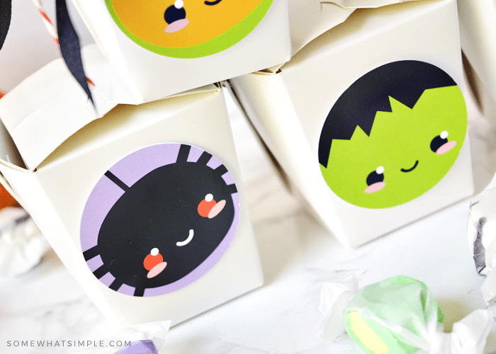takeout boxes with these halloween printables on the side