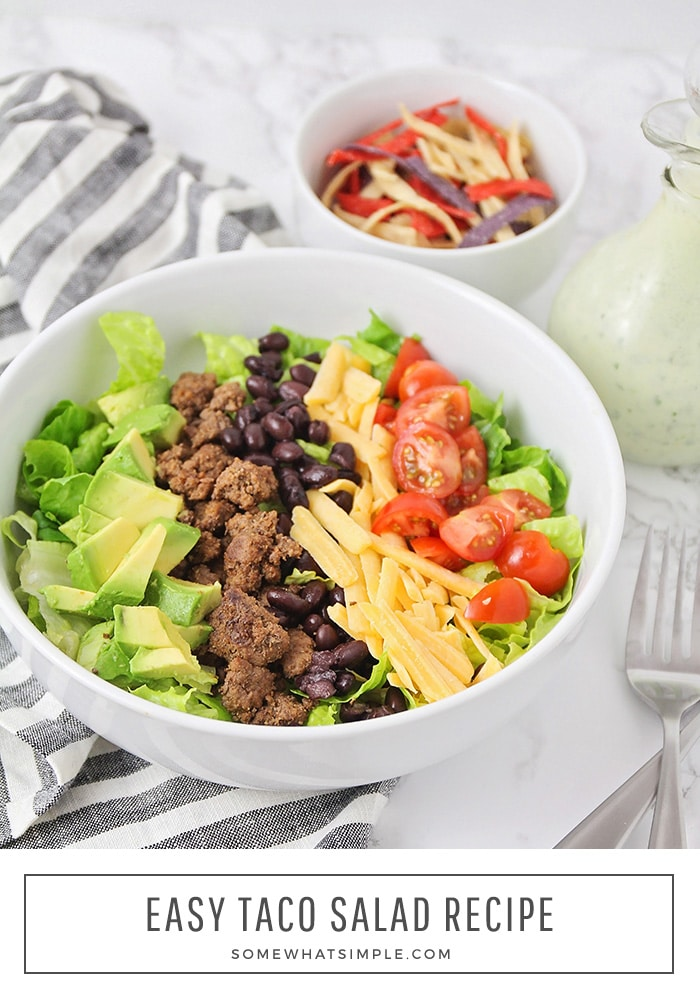 This simple and delicious taco salad recipe is ready in less than 20 minutes. Made with crunchy lettuce, ground beef and healthy vegetables, it's sure to please even the pickiest of eaters! #tacosalad #tacosaladrecipe #easytacosaladrecipe #tacosaladdressing #healthytacosalad via @somewhatsimple