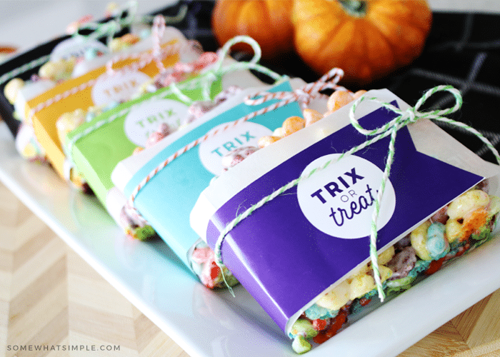 Trix rice krispies treats wrapped in gift tags that say trix or treat