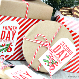 Free 12 Days of Christmas Gift Tags shown on red and white packages under the tree
