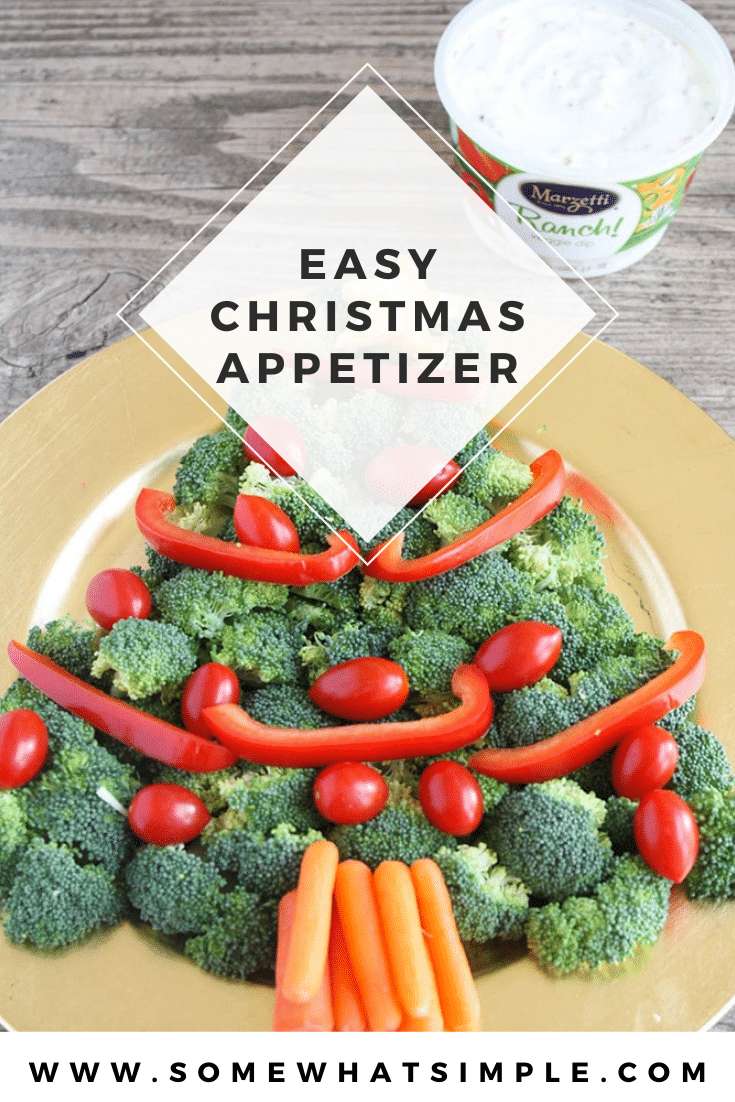 This Christmas tree veggie tray is simple and easy to make. The kids will love helping you arrange the veggies on the tray to make a fun Christmas tree shape that's perfect for the holidays. This veggie tray idea is simple and festive and makes the perfect holiday appetizer. via @somewhatsimple