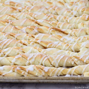 cinnamon bread twists with icing drizzled over the top