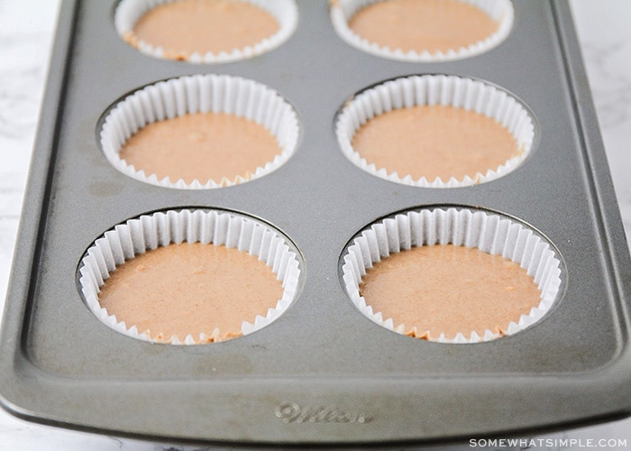 uncooked cupcake batter in a muffin tin