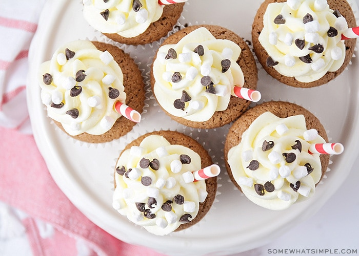 looking down on cupcakes topped with white frosting and chocolate chips