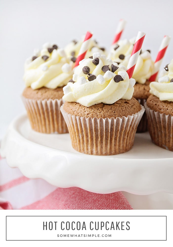 a tray of hot cocoa cupcakes with vanilla frosting