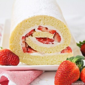 a strawberry shortcake roll on a serving platter
