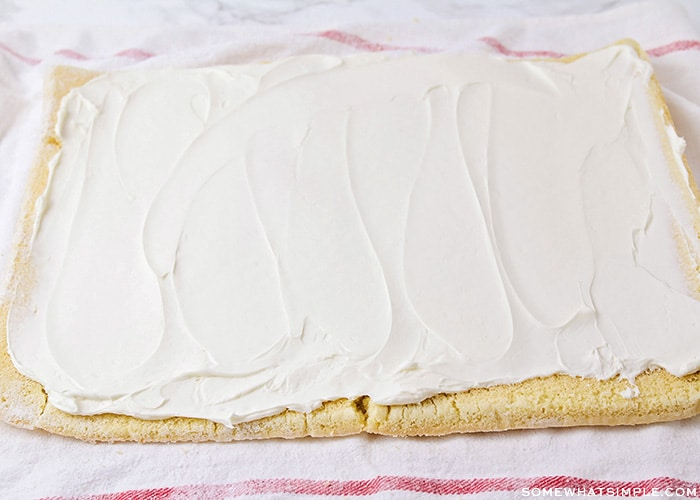 cream cheese filling spread over a rectangle cake