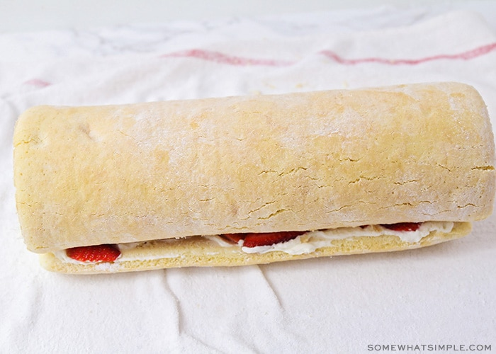 a strawberry shortcake roll on a towel