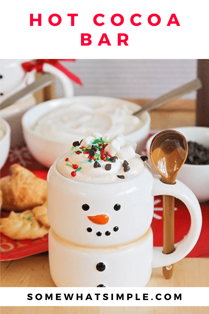 This sweet hot cocoa bar is a fun way to celebrate the season! Set out mix-ins, serve treats on the side, and enjoy a cup of holiday cheer! It's perfect to serve at your next holiday party or set it out for the family as a Christmas treat. via @somewhatsimple