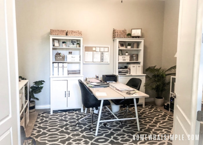 a home office with a desk for two people