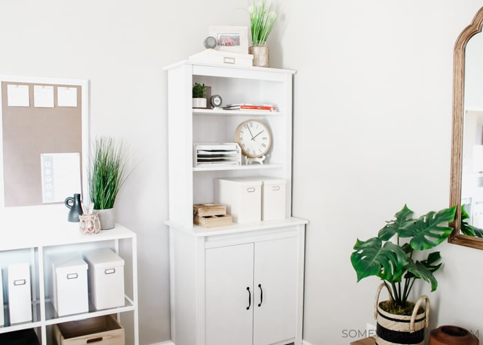 a cabinet and shelving unit for a home office