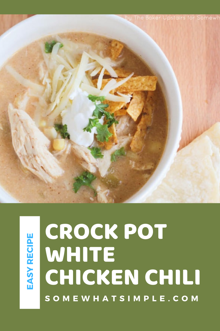 This slow cooker white chicken chili recipe is the perfect dinner on a chilly day.  Filled with tender chicken, white beans, vegetables and cream cheese, it doesn't get any better than this comfort food! via @somewhatsimple