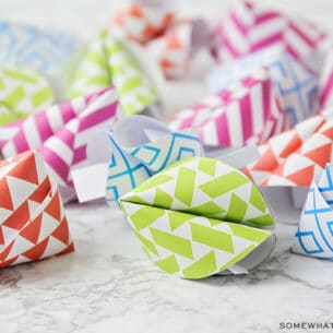 brightly colored fortune cookies made out of paper