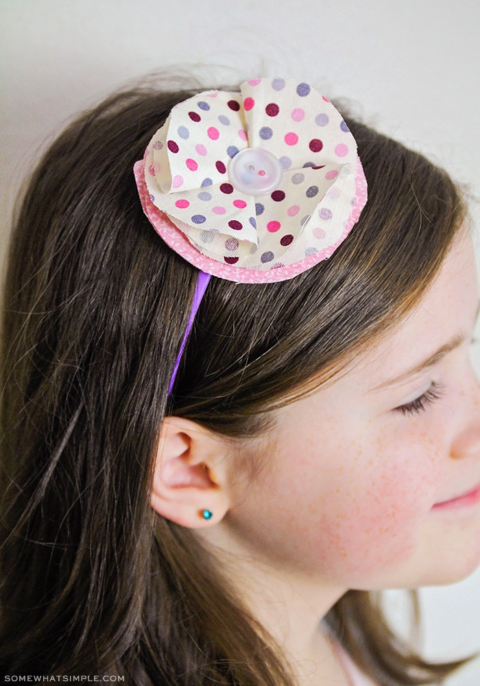 a headband with a fabric flower on top