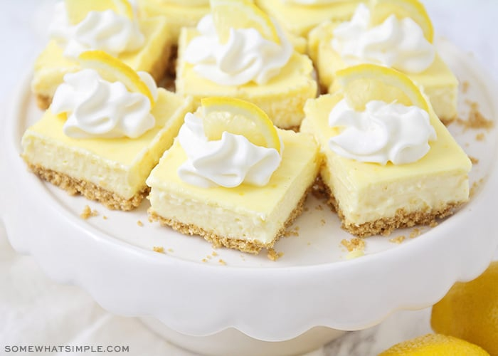 lemon cheesecake bars on a cookie stand