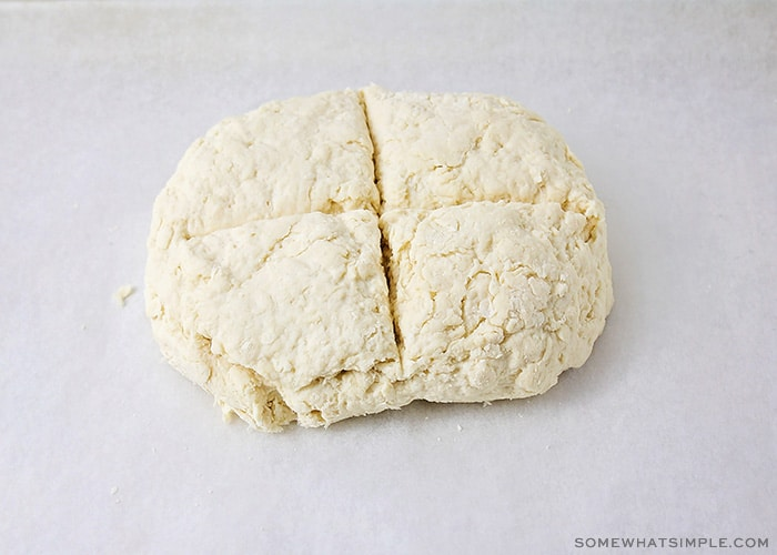 bread dough with a cross cut into it