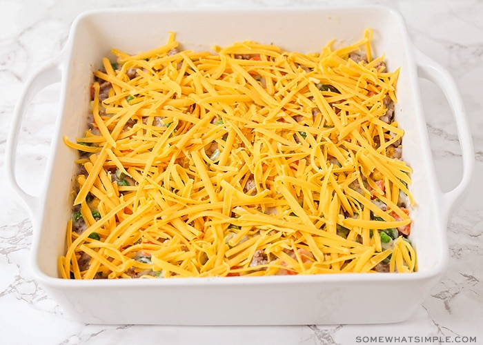 a casserole topped with shredded cheese