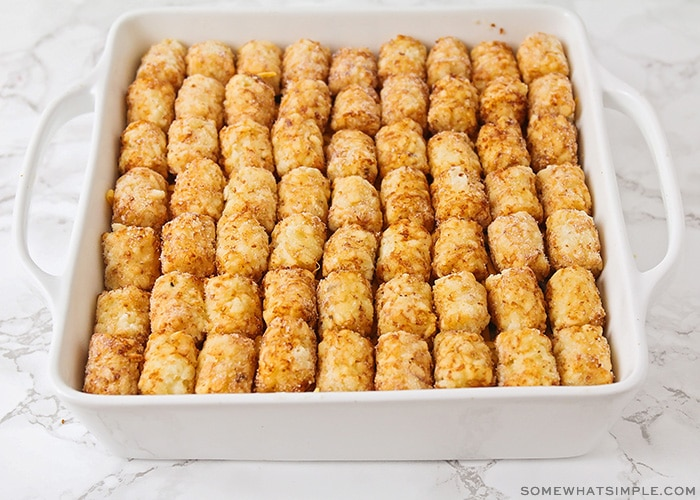 a casserole topped with rows of tater tots