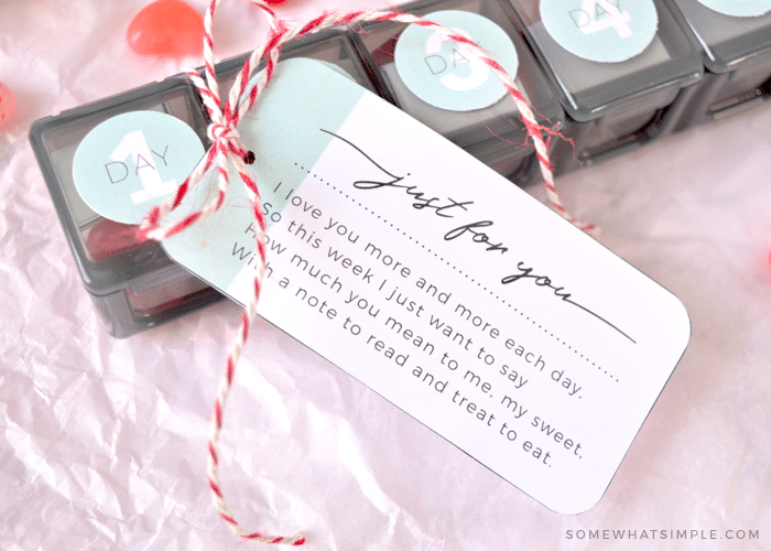 a weekly vitamin box with a love note attached