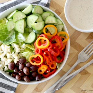 colorful garden salad with creamy italian dressing