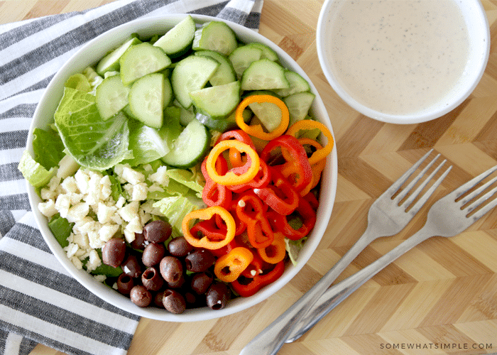 a garden salad with a side of homemade Italian dressing