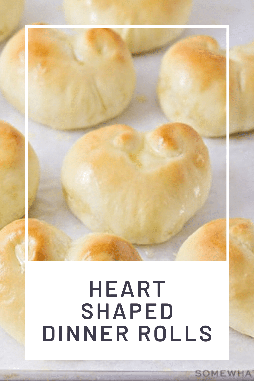 These heart shaped dinner rolls are a fun addition to any romantic homemade dinner. In just a few simple steps you can transform what would be ordinary bread into a heart shaped masterpiece. Whether it's Valentine's Day your anniversary or any other special occasion, this bread is perfect for that special dinner. via @somewhatsimple
