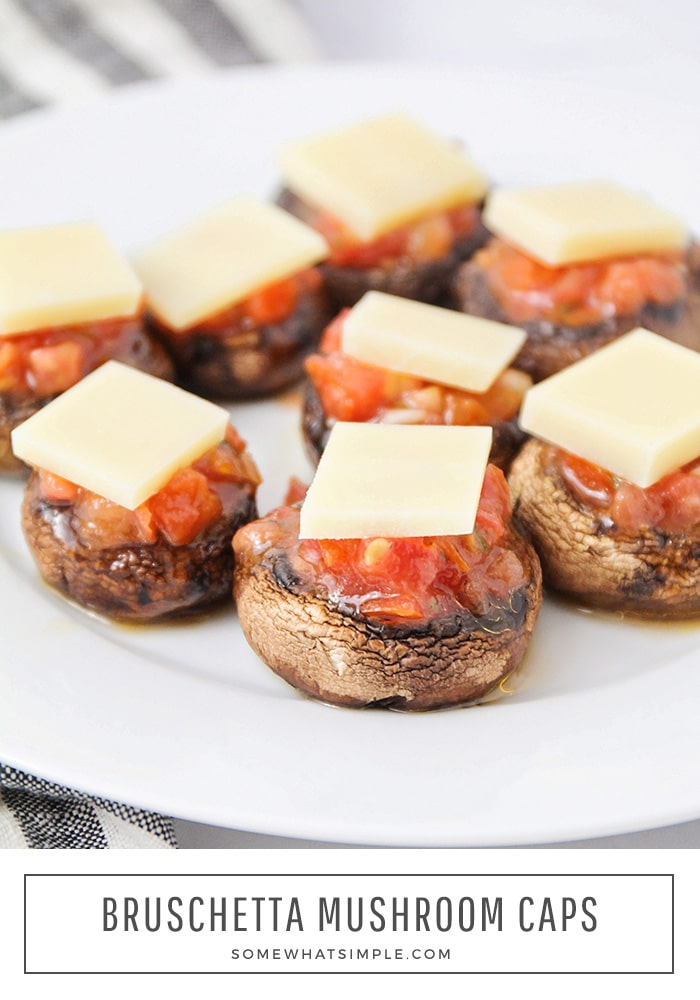 These bruschetta stuffed mushrooms are a tasty, healthier option for your next celebration or gathering.  Now you can enjoy a classic party bruschetta without all of the carbs.  #bruschetta #stuffedmushrooms #ketomushroomcaps #stuffedportobellomushrooms #easyappetizer via @somewhatsimple