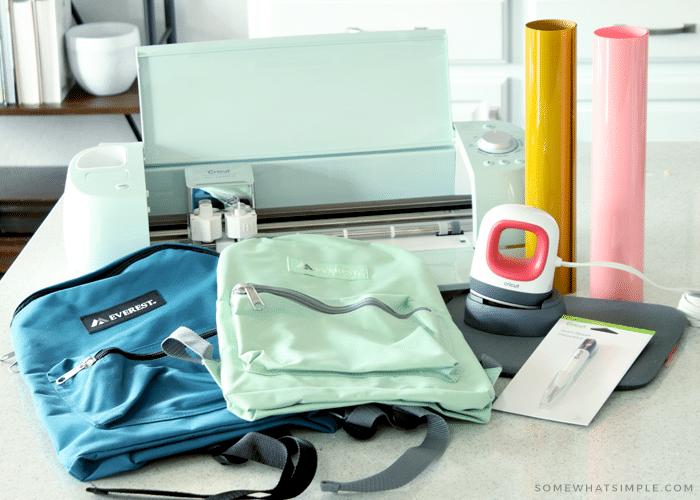 backpacks next to a Cricut machine