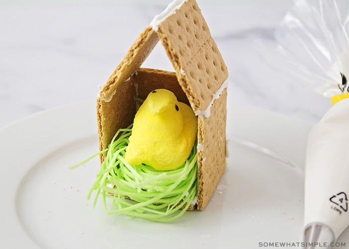 a peep candy inside a graham cracker birdhouse