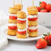 a plate of strawberry shortcake kabobs