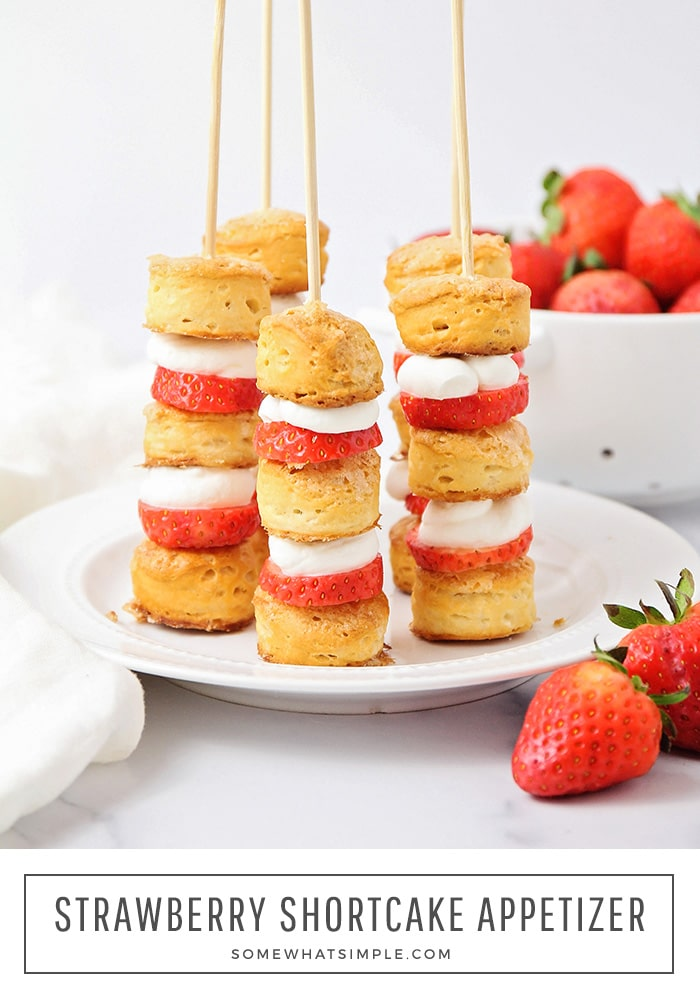 Strawberry Shortcake kabobs are fresh, easy and delicious! Layers of sweet biscuits, whipped cream, and tart strawberries make a simple appetizer or dessert that looks impressive!#strawberryshortcakeappetizer #strawberryshortcake #easystrawberryshortcakeappetizer #strawberryshortcakeappetizerrecipe via @somewhatsimple