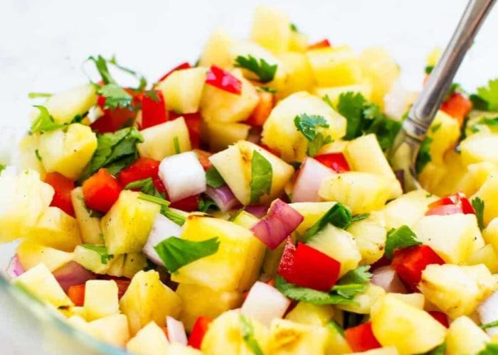 a bowl of homemade pineapple salsa