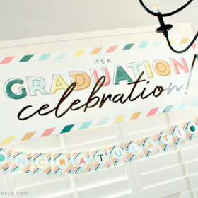 graduation party with hanging banner on the window