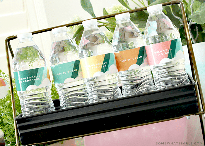 water bottles for a graduation wrapped in cute labels with stripes