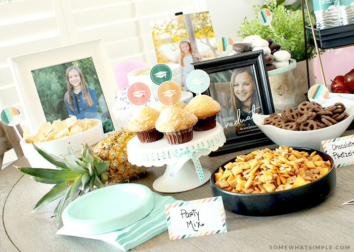 A table with treats and finger foods for a graduation party