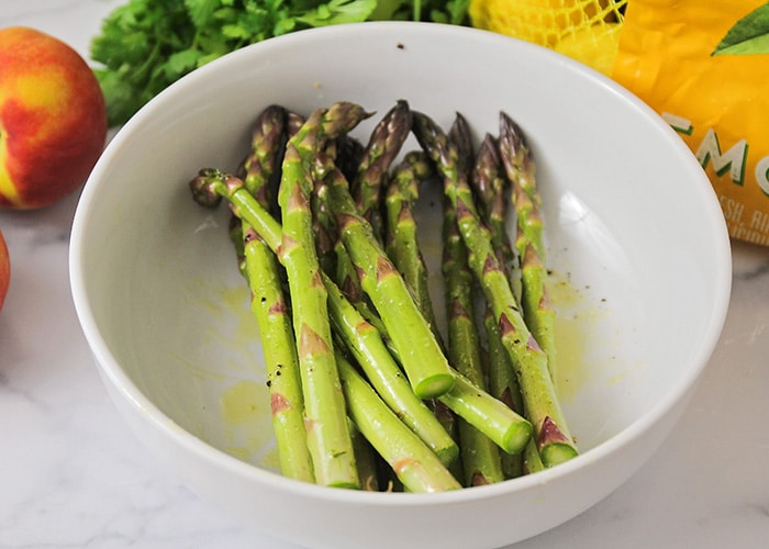 trimmed asparagus in a white bowl