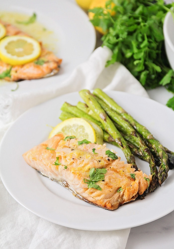 grilled salmon and asparagus on a white plate
